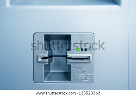 Empty ATM cash point slot with subtle blue cast - stock photo