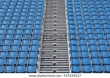 Empty audience blue plastic seats at the stadium - stock photo