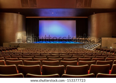 Empty auditorium with all lights on. - stock photo
