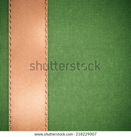 Empty banner on vintage background. Brown ribbon on green fabric cloth texture with copy space. Square format - stock photo