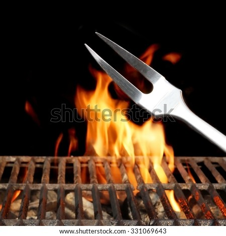 Empty Barbecue Grill With Bright Flames Closeup Isolated on Black Background With Copy Space - stock photo