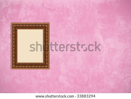 Empty baroque picture frame with copyspace on a pink grunge stucco wall - stock photo