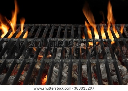 Empty BBQ Flaming Charcoal Grill With Bright Flames Of Fire Isolated On The Black Background, Close Up, Copy Space, Top View. Cookout Food Concept - stock photo
