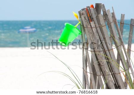 Empty beach with sand dune fence - stock photo