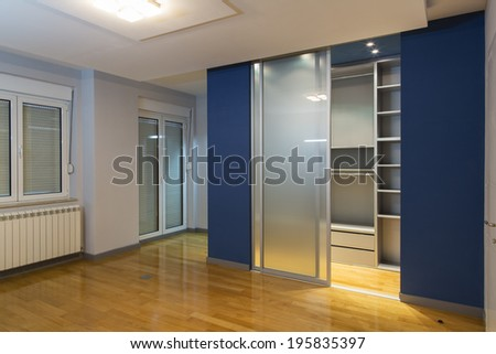 Empty bedroom and wardrobe interior - stock photo