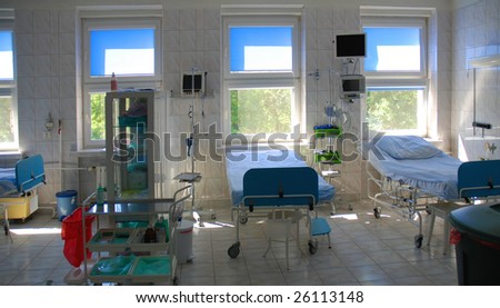 Empty beds in a hospital room - stock photo