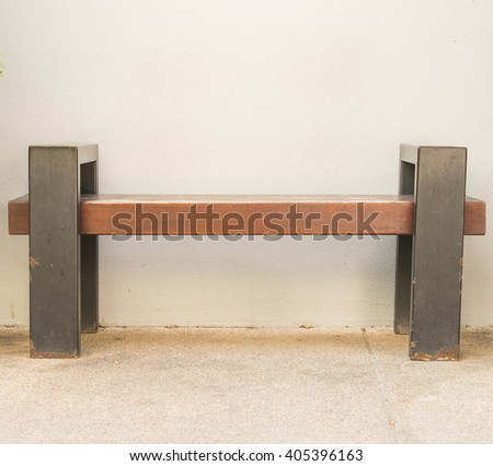 empty bench with wall background - stock photo