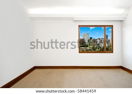 Empty big new room with a beautiful cityscape view - stock photo