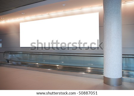 empty billboard and modern escalator at a international airport - stock photo