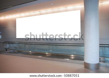 empty billboard and modern escalator at a international airport - stock photo