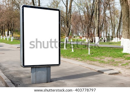 Empty billboard or lightbox on green city street with white isolated background - stock photo