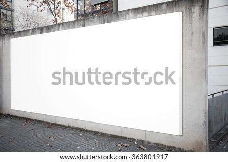 Empty billboard screen on the concrete gray background.  - stock photo