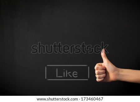 Empty black copyspace with Like button and hand showing thumb up gesture - stock photo