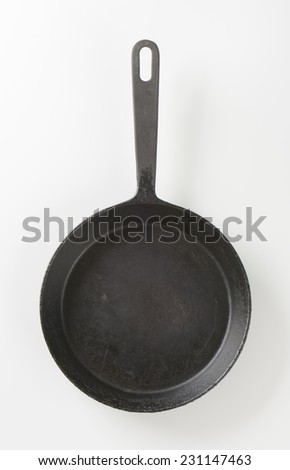 empty black frying pan on white background - stock photo