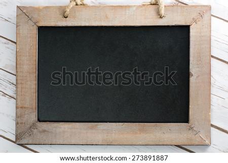 empty blackboard with wooden frame / empty blackboard - stock photo
