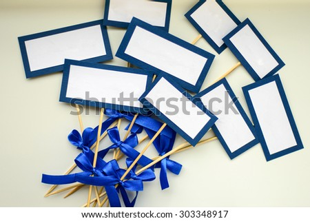 Empty blank card and copy-space for example guest names or dishes in wedding restaurant in blue tones - stock photo