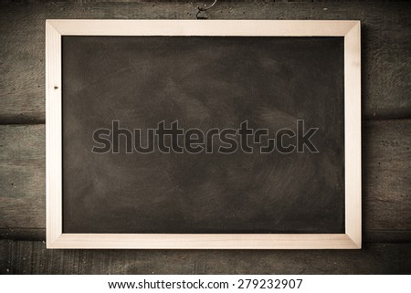 empty Blank chalkboard in wooden frame isolated on wooden background - stock photo