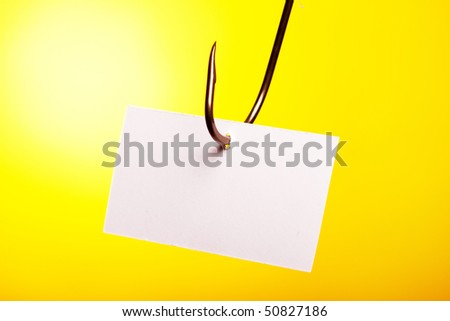 Empty blank peace of paper pierced in hook - stock photo