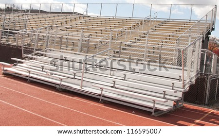 Empty Bleachers of  High School Football and track and Field Stadium - stock photo