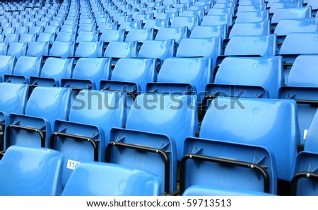 empty blue stadium seats - stock photo