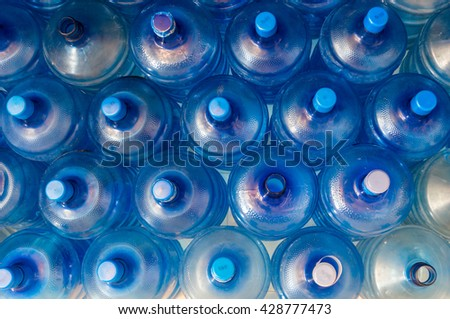 empty blue transparent waters gallon, Overlapping background - stock photo