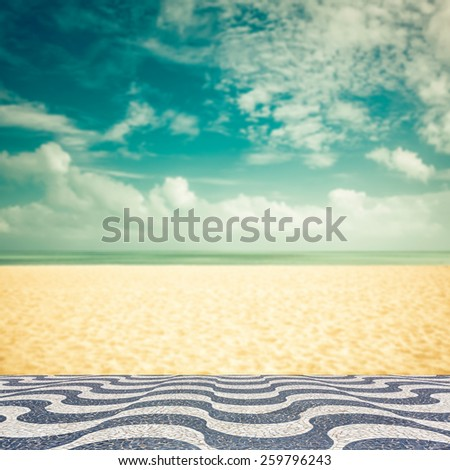 Empty blurred beach with Copacabana mosaic - vintage look - stock photo