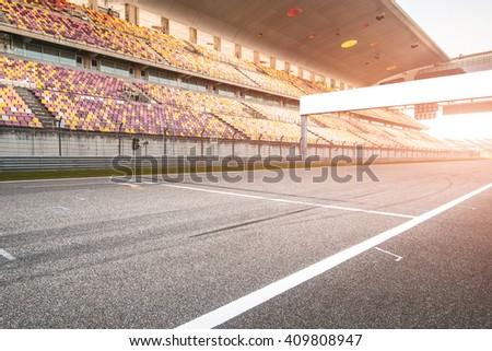 Empty board above an international racetrack.  - stock photo