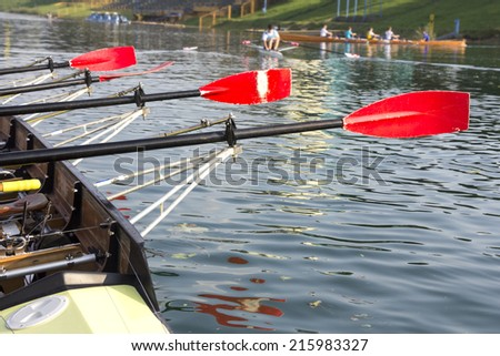 Empty boat with a red paddle on the lake  - stock photo