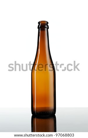 Empty bottle of beer isolated on white background. - stock photo