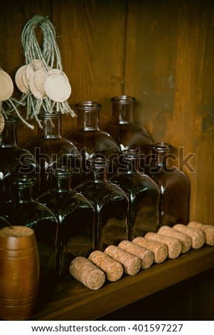 Empty bottles on the shelf - stock photo