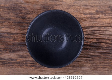 Empty bowl on wood - stock photo