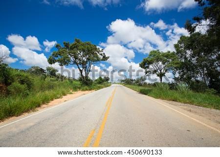 empty brazilian road at sunny cloudy day - stock photo