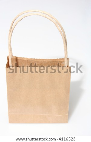 Empty brown paperbag isolated on white, perfect to put your design on the side, frontal view - stock photo
