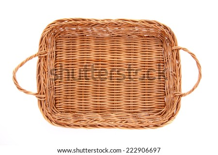 Empty brown wicker basket isolated on white background, top view - stock photo