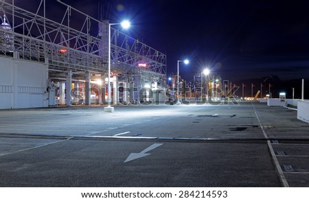Empty car park at night - stock photo