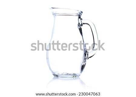 empty carafe of milk isolated on white background with reflection side view - stock photo