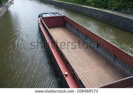 empty cargo boat on river Meuse - Namur, Belgium - stock photo