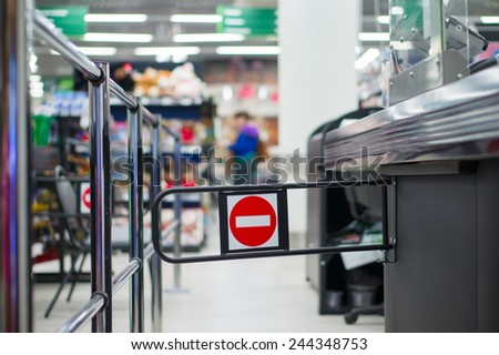 Empty cash desk with closed way border in supermarket - stock photo