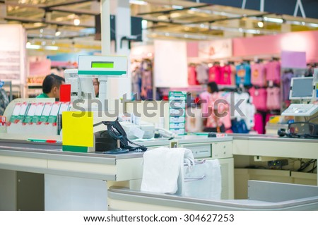 Empty cash desk with computer terminal in mall - stock photo