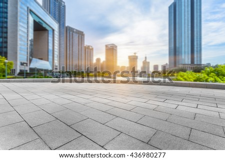 empty cement floor and modern buildings,tianjin china. - stock photo