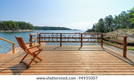 Empty chair in terrace, hot sunny summer day, open sky. - stock photo