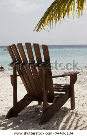 Empty chair in the caribbean - stock photo
