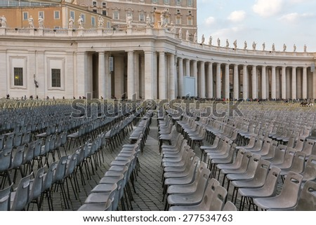 Empty chairs behind Cathedral of Saint Peter (Basilica di San Pietro), Vatican, Rome, Italy - stock photo