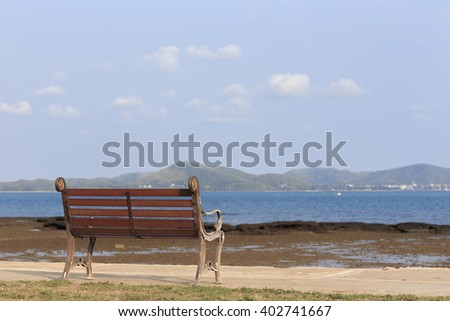 empty chairs on beach in evening with view on the sea - stock photo