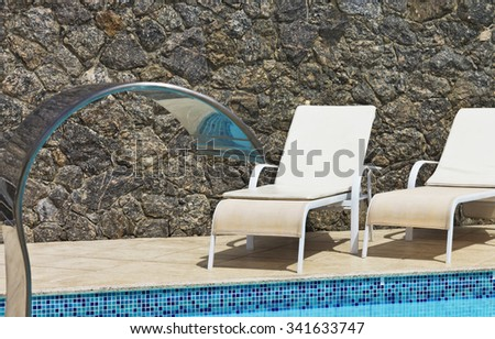 Empty chairs - the pool â?? sunbeds - stock photo