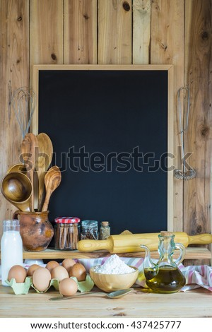 Empty chalkboard with a copy space, pastry ingredients and cooking tools - stock photo