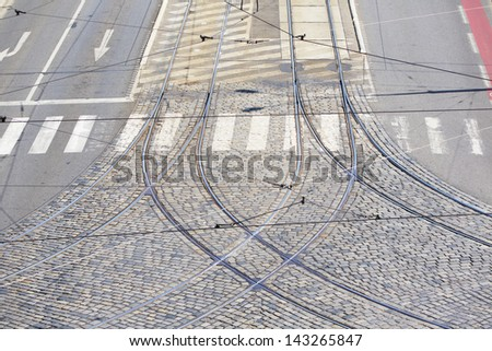 Empty city intersection in Prague - railroad of tram and road - stock photo