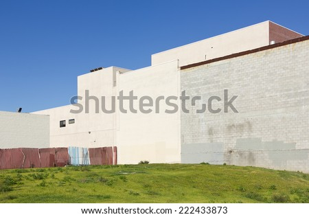 Empty city lot sits up against some building walls.   - stock photo