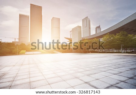 empty city square with skycrapers and trees - stock photo