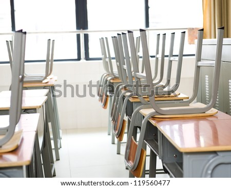 Empty classroom with chairs and desks. - stock photo